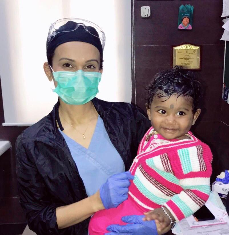 Smile Train Fellow Dr. Jazna Jalil holds a child after her cleft surgery at BMJH in Bangalore