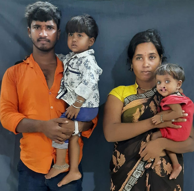 Sonali and Arjun hold their daughters before Aaroni's cleft surgery