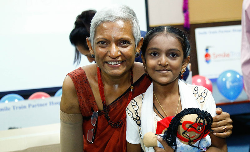 Dr Murthy with child